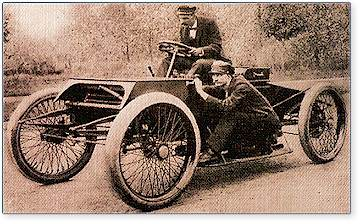 "The ""Sweepstakes "" racer of 1901, with Henry Ford at the wheel and  Ed Huff on running board."