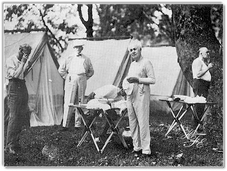 Shaving time on a summer morning in 1921 in the Great Smokies. Left to right: Henry Ford, Bishop William F. Anderson, Harvey Firestone (stooping). Thomas A. Edison and President Warren G. Harding. Ford seems to be managing without a mirror, perhaps in deference to the President who is making use of one. Bishop Anderson, fully dressed, apparently was an early riser. Firestone, Edison and the President display a variegated assortment of undershirts.
